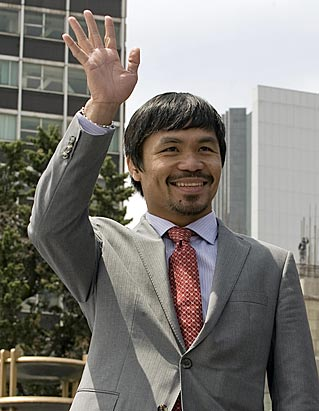 For some people, Manny Pacquiao's enthusiasm for cockfighting detracts from his admirable accomplishments in and out of boxing. (Getty Images)