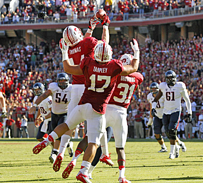Stanford outside linebacker Chase Thomas (44) intercepts a tipped pass by Matt Scott in overtime. (US Presswire)