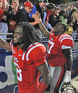 Jerrell Powe (right) took a long road to Ole Miss, but is still staying for his four years. (US Presswire)