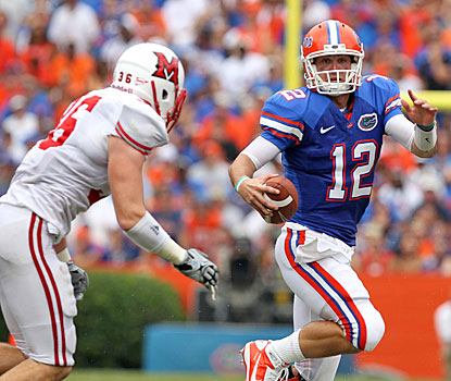John Brantley feels heat from the Miami defense and his own fans in a less-than-stellar debut as Florida's starting QB.  (US Presswire)