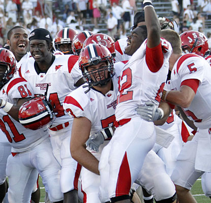 Jacksonville State players celebrate after the Gamecocks notch their first win over an FBS team since 2001.  (AP)