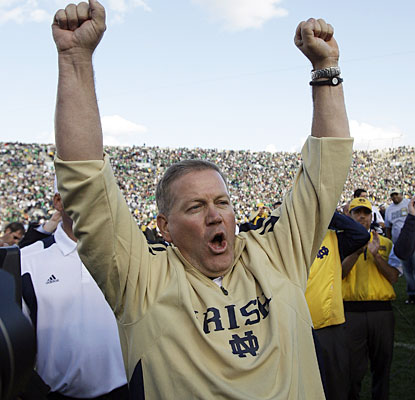 Brian Kelly is all smiles after winning his Notre Dame debut, which gives Irish coaches a 26-3 record in their debuts. (AP)