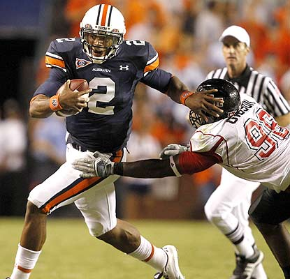 Not bad for his first start. Cam Newton throws for 186 yards and runs for 171 more in Auburn's win. (AP)