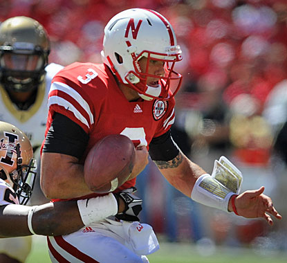 Taylor Martinez coughs up the ball near the goal line, but falls on it in the end zone for a Nebraska touchdown.  (AP)