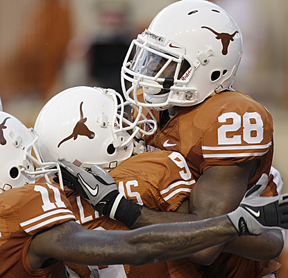 Fozzy Whittaker (28) of Texas celebrates with teammates after scoring in the second quarter.  (AP)