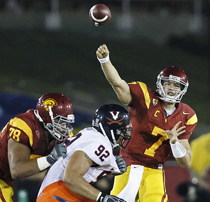 Quarterback Matt Barkley provides both touchdowns for his Trojans, both coming in the first half against Virginia.  (AP)