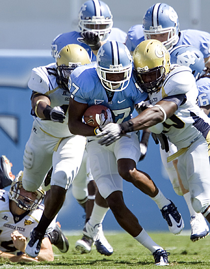 North Carolina's Jheranie Boyd (center) is brought down by Georgia Tech's Julian Burnett (right).   (AP)