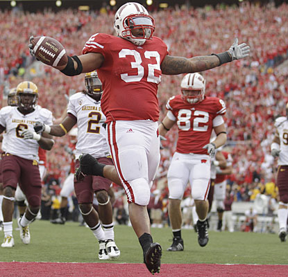 John Clay runs for 123 yards and the go-ahead touchdown as Wisconsin survives a scare. (AP)