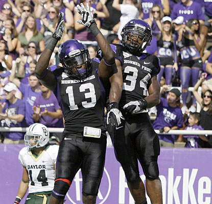 Ed Wesley (34) celebrates one of his two touchdowns with Antoine Hicks as TCU rolls to victory.  (AP)
