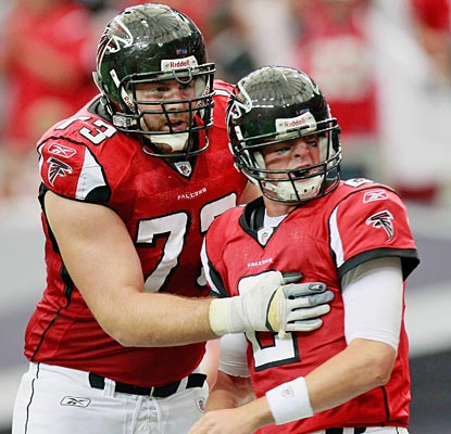 Harvey Dahl appreciates the work of Matt Ryan, who also seems pretty pleased with his three-TD day.  (Getty Images)
