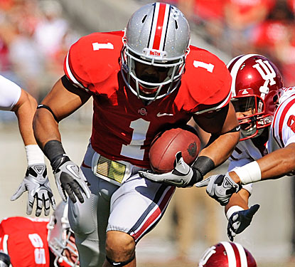 Dan Herron breaks through the line on the way to one of his two touchdowns for the Buckeyes.   (Getty Images)