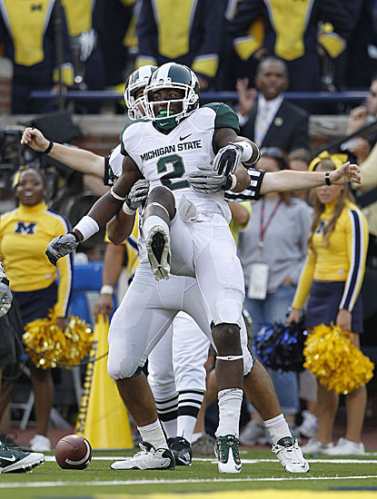 Michigan State's Mark Dell (2) celebrates a third-quarter touchdown reception from Kirk Cousins.  (Getty Images)