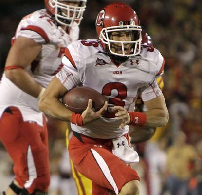 Utah quarterback Jordan Wynn runs from Iowa State's Patrick Neal.  (AP)