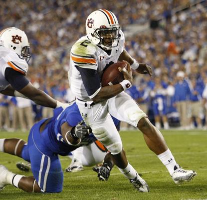 Auburn quarterback Cameron Newton breaks toward the end zone on his third touchdown run of the first half. (AP)