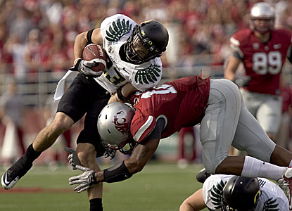 Oregon receiver Jeff Maehi is tackled by Washington State's C.J. Mizell.  (AP)