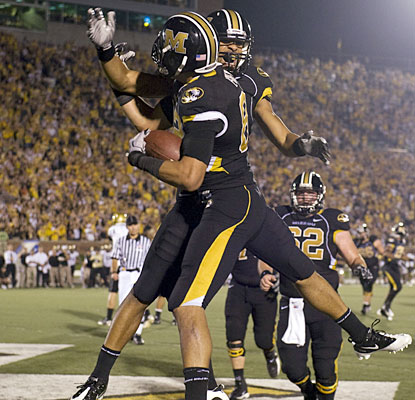 Missouri receiver Michael Egnew, left, celebrates his fourth-quarter touchdown with Wes Kemp.  (AP)