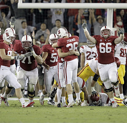 Stanford players celebrate after Nate Whitaker nails a 30-yard field goal with no time left.  (AP)