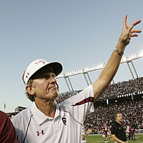 Steve Spurrier waves to the crowd after beating 'Bama. But will beating No. 1 breed success? (AP)