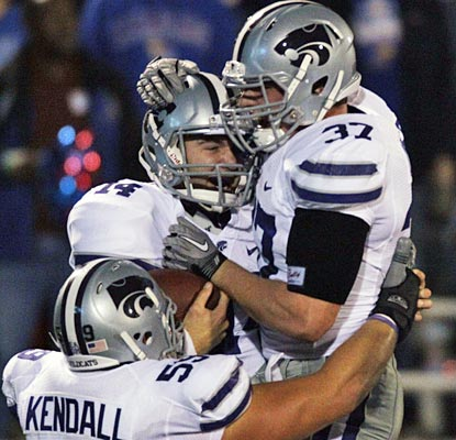 The Wildcats seem appreciative of Carson Coffman (center), who scores five total touchdowns.  (AP)