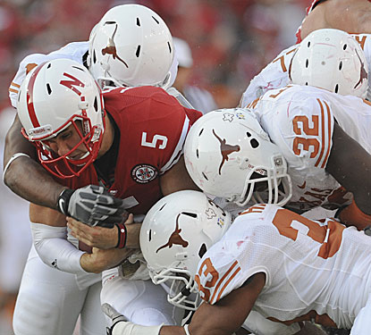 Nebraska's Zac Lee, who replaced Taylor Martinez, is swarmed over by Longhorns.  (AP)
