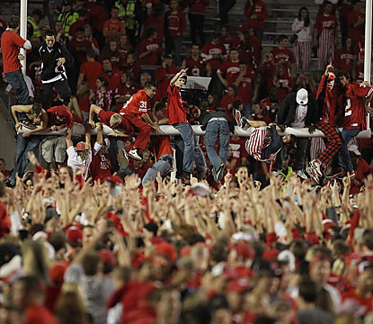 Wisconsin fans don't wait long to celebrate as they rush the field seconds after their Badgers knock off No. 1 Ohio State. (Getty Images)