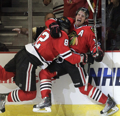 The Blackhawks' Patrick Sharp (right) celebrates with Tomas Kopecky after scoring the game-winning goal. (Getty Images)
