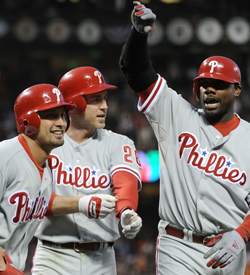 Shane Victorino, Chase Utley and Ryan Howard refuse to be phased by the Giants. (Getty Images)