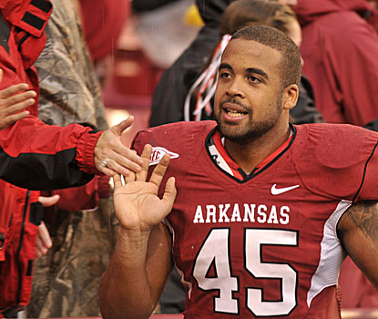 Arkansas tight end D.J. Williams greets fans after Saturday's win at Fayetteville.  (AP)