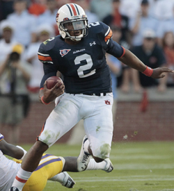 Auburn QB Cameron Newton runs for 217 yards in a 24-17 win over LSU. (AP)