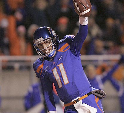 Boise State quarterback Kellen Moore celebrates after catching a touchdown pass off a gadget play late in the third quarter.  (AP)