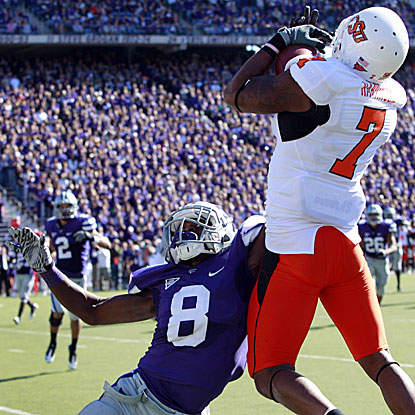 Oklahoma State's Michael Harrison (7) catches a TD pass as K-State's Stephen Harrison defends.   (AP)