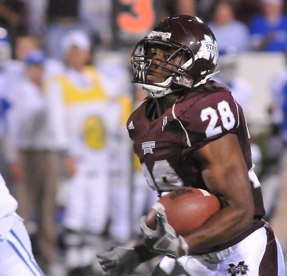 Mississippi State RB Vick Ballard -- 103 rushing yards -- sprints for a touchdown against Kentucky. (Getty Images)