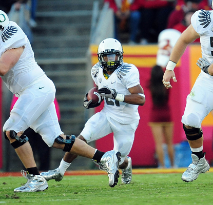 The Ducks' LaMichael James runs for 239 yards and three TDs as No. 1 Oregon fends off No. 24 USC.  (US Presswire)
