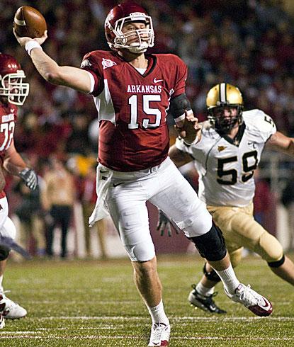 Arkansas quarterback Ryan Mallett throws while being pursued by Vandy's Adam Smotherman.  (AP)