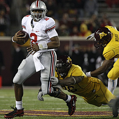 Ohio State quarterback Terrelle Pryor breaks a tackle during a 13-yard run against Minnesota.  (AP)