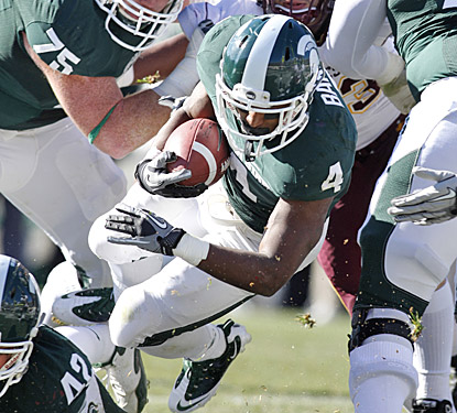 Edwin Baker helps Michigan State shake off its first loss with 179 yards and four touchdowns vs. Minnesota.  (AP)