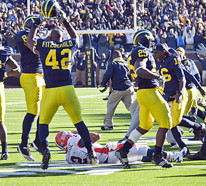 Michigan's defense can celebrate after stopping Nathan Scheelhaase's try at a game-tying two-point conversion.  (AP)