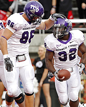 TCU's Corey Fuller and Waymon James celebrate after James scores on a fumble recovery. (AP)