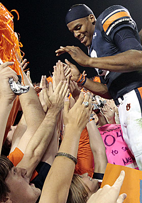QB Cam Newton revels in the adoration of Auburn faithful after the Tigers beat Georgia on Saturday. (AP)