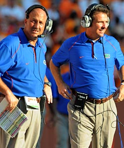 Steve Addazio (left) has drawn a lot of heat for the Gators' lackluster offense, but Urban Meyer is keeping him. (US Presswire)