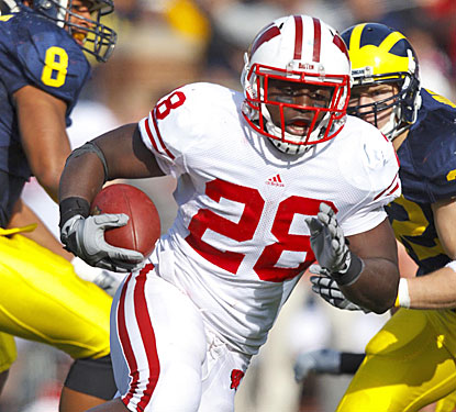 Montee Ball rushes for 173 yards and four TDs to keep Wisconsin in line for its first Big Ten title since 1999.  (US Presswire)