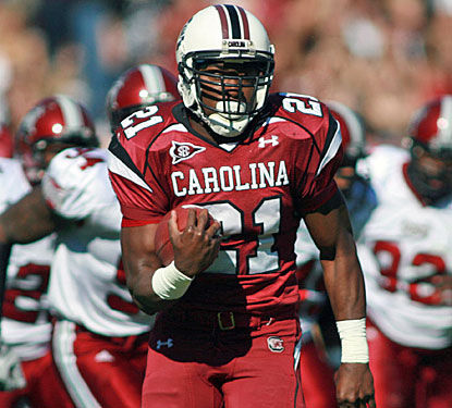 Marcus Lattimore scores three touchdowns, moving within one of Reggie Cobb's 1987 SEC record for freshmen.  (US Presswire)