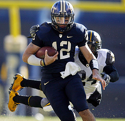 Pitt QB Tino Sunseri tries to evade a West Virginia defender. (US Presswire)