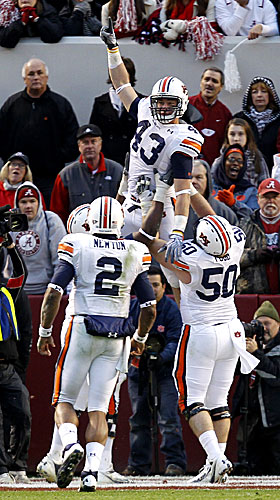 Auburn's Philip Lutzenkirchen celebrates his TD with Ryan Pugh (50), Cam Newton (2),  Mike Berry. (AP)