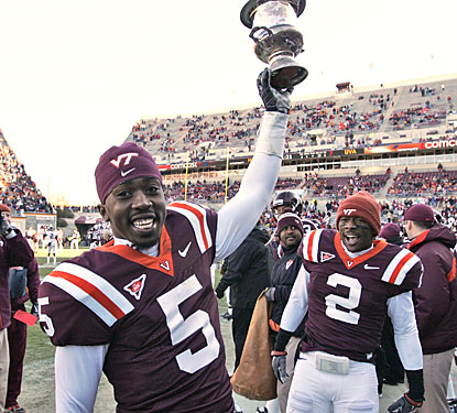 Tyrod Taylor, Virginia Tech's new career leader in passing yards, celebrates another defeat of Virginia.  (AP)