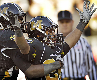 De'Vion Moore scores on Missouri's first drive, then caps the Tigers' output with a fourth-quarter touchdown.  (AP)