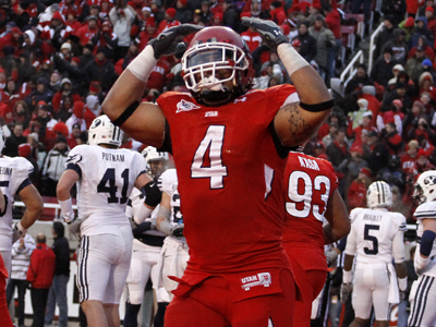 Utah running back Matt Asiata celebrates after scoring his teams only rushing TD against the Cougars. (AP)