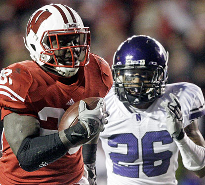 Montee Ball continues to dominate for the Badgers, rushing for 178 yards and four TDs vs. Northwestern.  (AP)