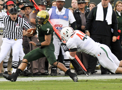USF QB B.J. Daniels evades Miami's Colin McCarthy on his way to lead the Bulls to a rousing 23-20 upset. (US Presswire)
