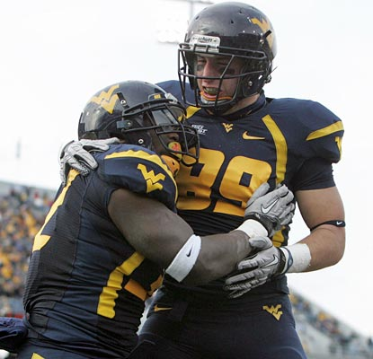 Ryan Clarke celebrates one of his three touchdowns on the day with Tyler Urban.  (US Presswire)